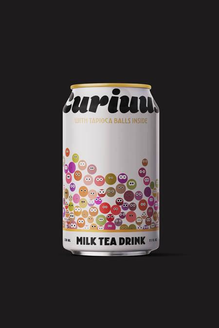 A milk tea drink with tapioca balls inside.